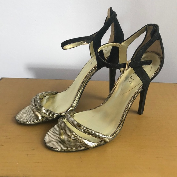 5372d5ee961 Strappy Guess stilettos black and gold